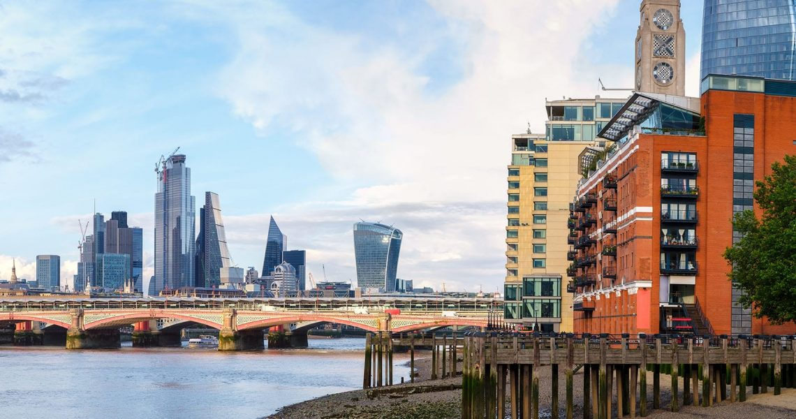 London at sunset with riverside buildings, Blackfriars Bridge and the City of London